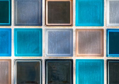 Wallpaper image of transparant glass tiles serving as colorful window
